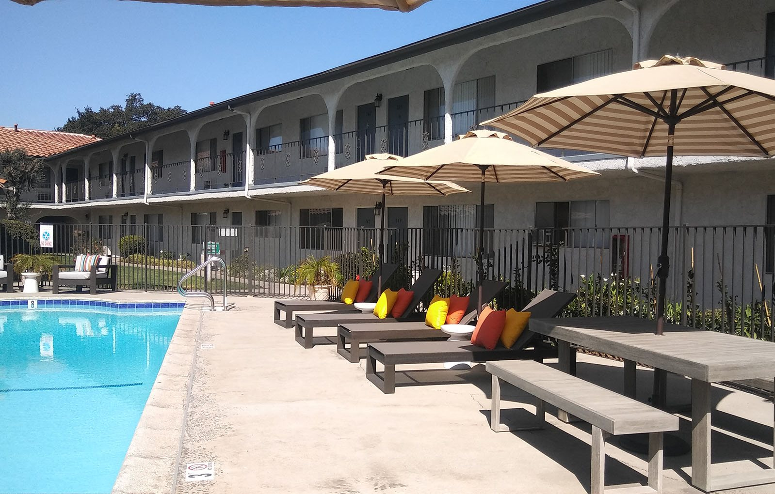 Pool view with Apts Buildings Villa Tramonti Apartment Homes | San Gabriel CA
