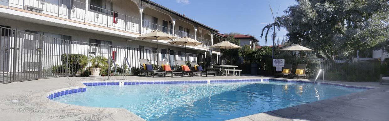 Pool view with Apts Buildings Villa Tramonti Apartment Homes | San Gabriel CA