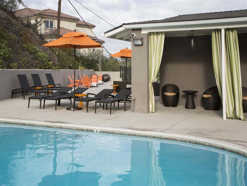 Apartments in Monterey Park, CA - Exterior View of Emerald Hills Swimming Pool With Lounge Chairs, Tents and Cabana