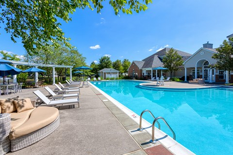 Apartments in Lawrence Township - The Mercer at Lawrence Station Apartments Resort-Style Pool Lined With Lounge Chairs And Shaded Seating
