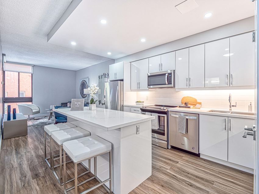 Open-concept kitchen in a renovated unit at  57 Charles