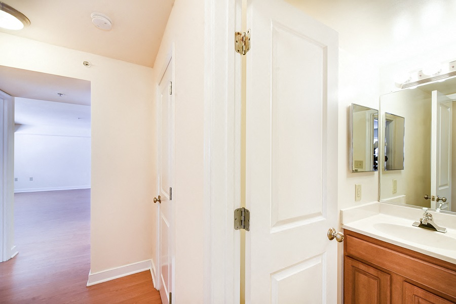 Jasper-Place-Apartments-Hallway-with-Bathroom-Door-and-Bedroom-Door