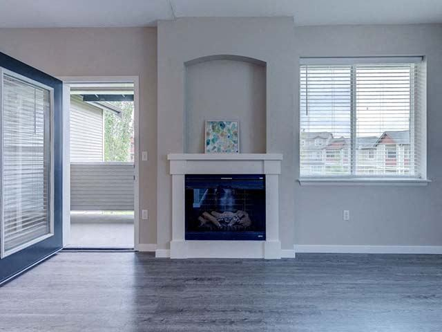 Apartments for Rent in Fife-Bella Sonoma Apartments Spacious Living Room With Large Windows And Fireplace With Mantle
