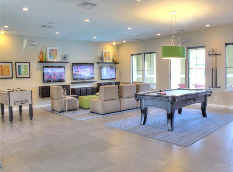 Community lounge with pool table, foosball table, and TVs