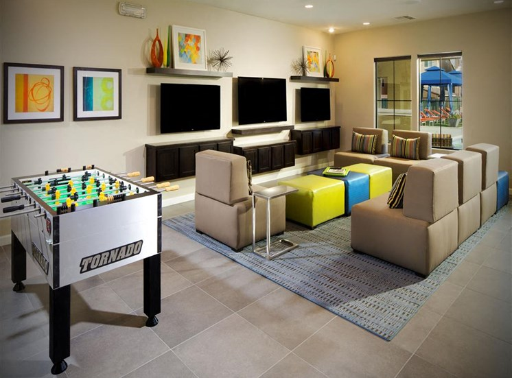 Community lounge with TVs and foosball table