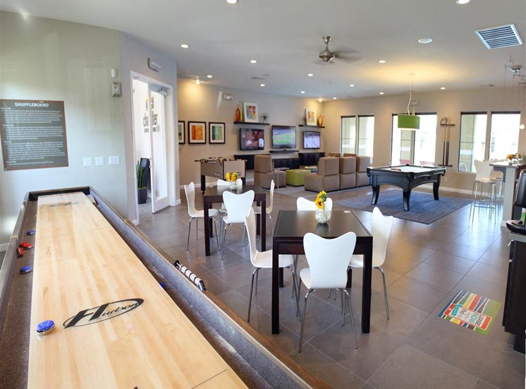 Shuffleboard in community area with plenty of room and seating