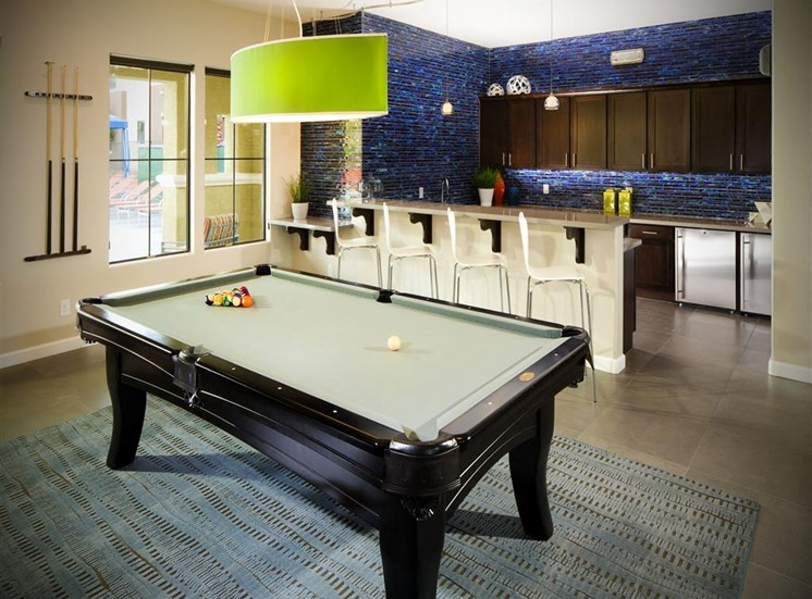 Community area with pool table, breakfast bar, and kitchen
