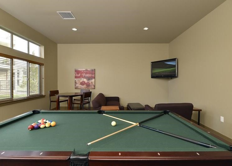 Pool Table with Seating and TVs Copper Steppe Apts in Parker Co