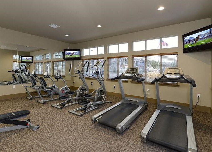 Gym with Cardio and TV Copper Steppe Apts in Parker Co