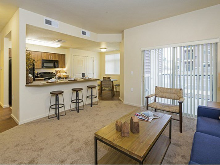 Full kitchen with dining area view Parker CO Apartment Rentals at Copper Steepe