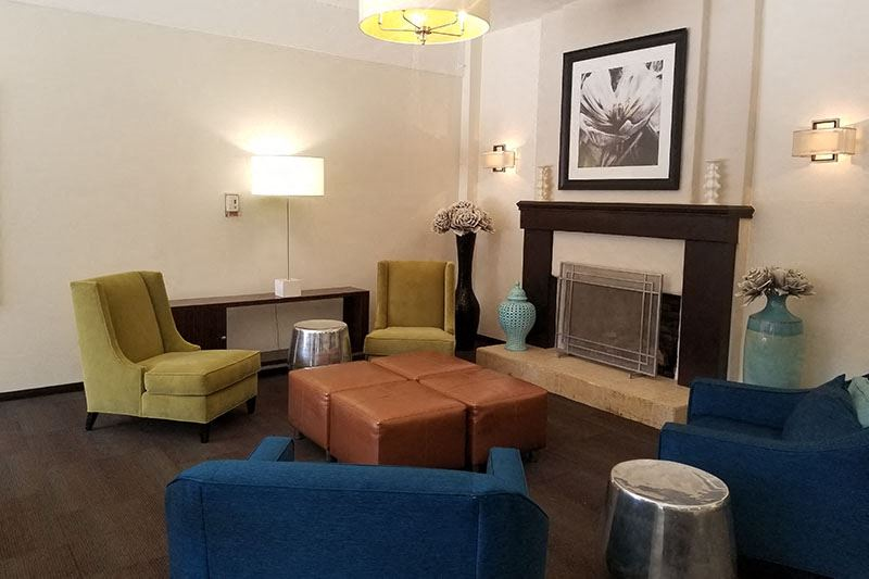 Covina Grand Apartment Rentals | Covina Seating Area by Fireplace