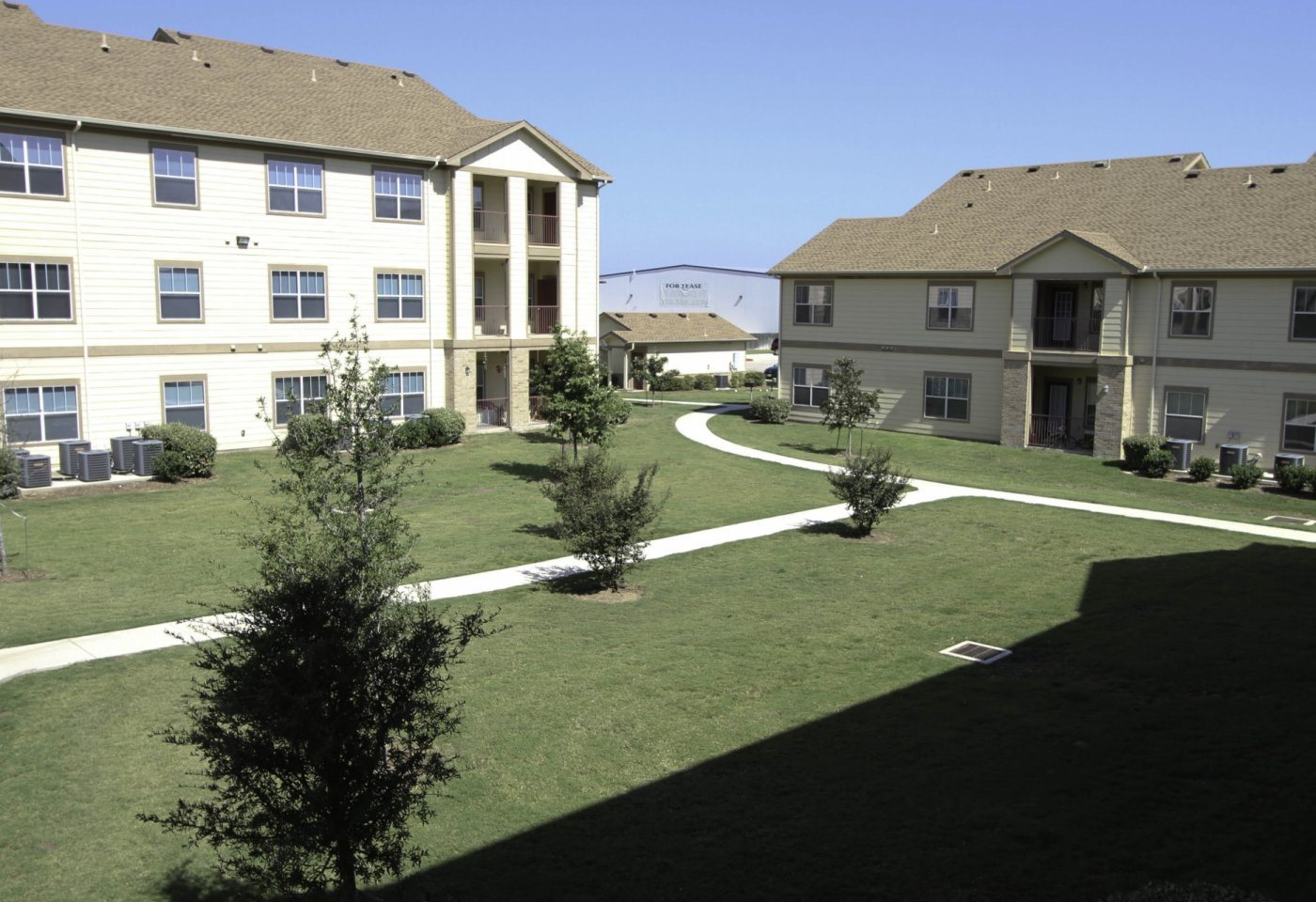 Grass Area and apt buildings La Sierra Apartments For Rent l New Braunfels TX