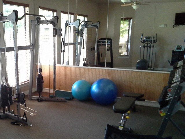 Gym with Fitness Center Equipment Pecan Point l Apartment Rentals in Temple, TX