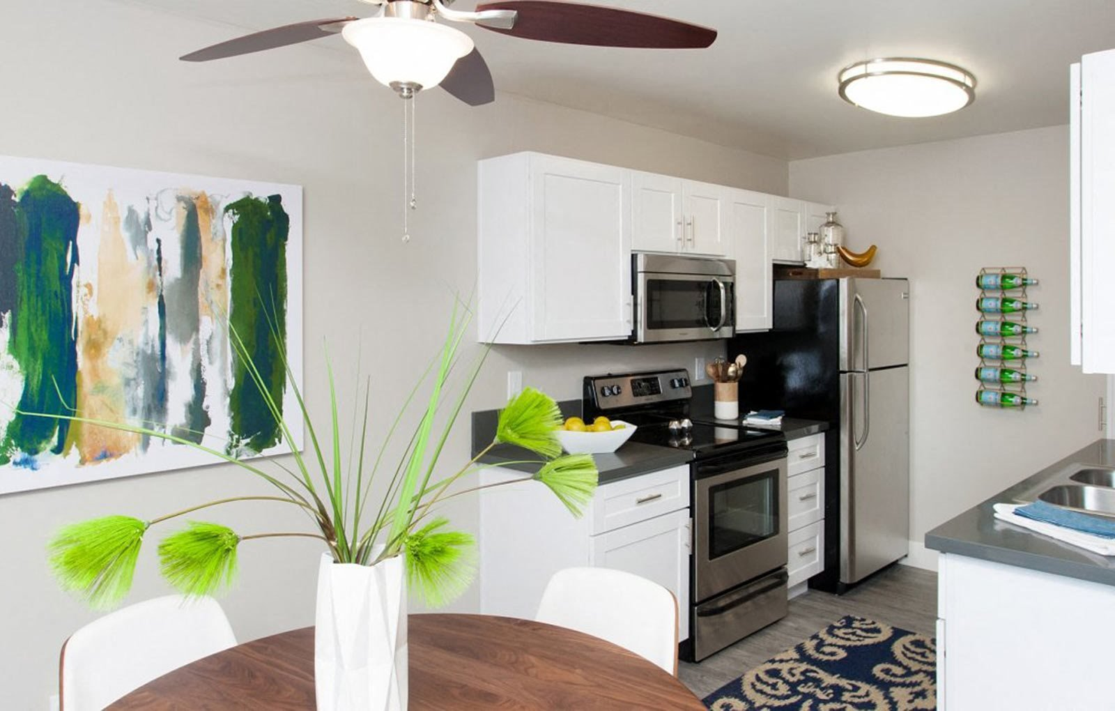 Kitchen and dining area| Stoneridge Luxury Apartments in Walnut Creek, CA