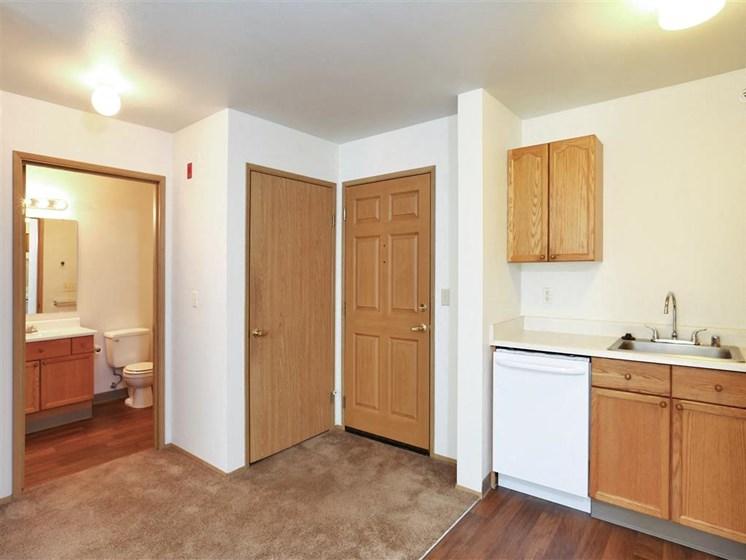 Entry way and Bathroom | The Vintage at Arlington apts in Arlington, WA