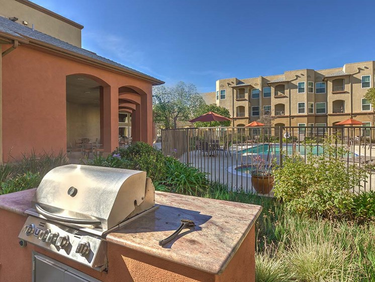 BBQ with view of pool  l Vintage at Bouquet Canyon Senior Apartments