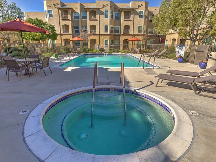 Spa and Pool with lounge chairs  l Vintage at Bouquet Canyon Senior Apartments