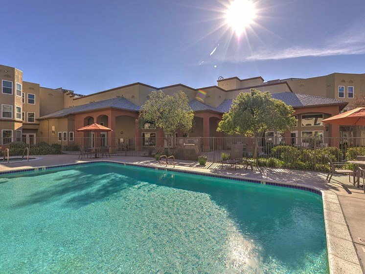 Pool with tables and seating  l Vintage at Bouquet Canyon Senior Apartments