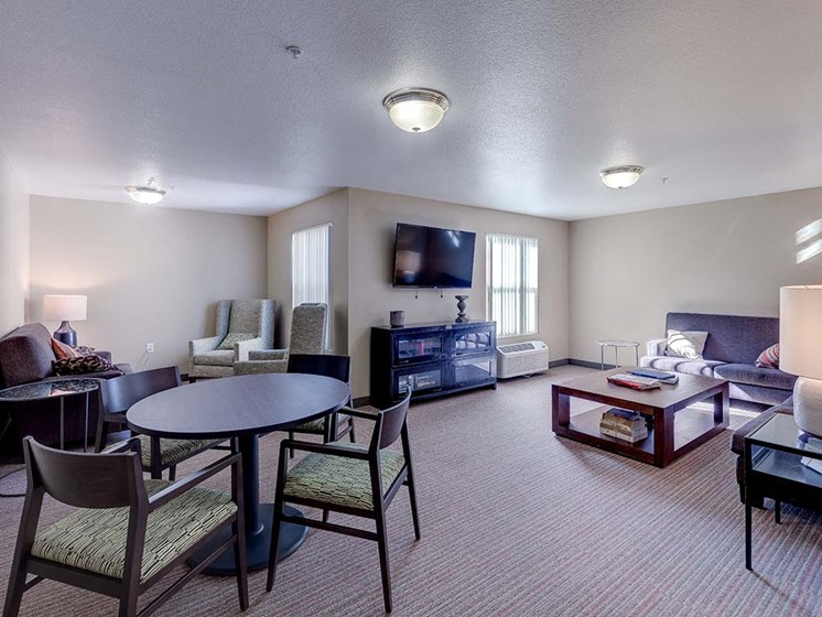 Room with TV and seating  l Vintage at Bouquet Canyon Senior Apartments