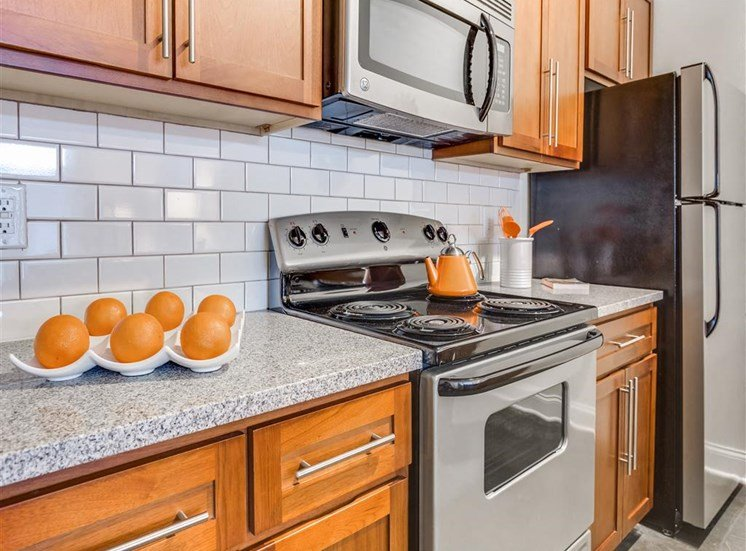 Electric Range In Kitchen at Greenway at Fisher Park, Greensboro, 27401