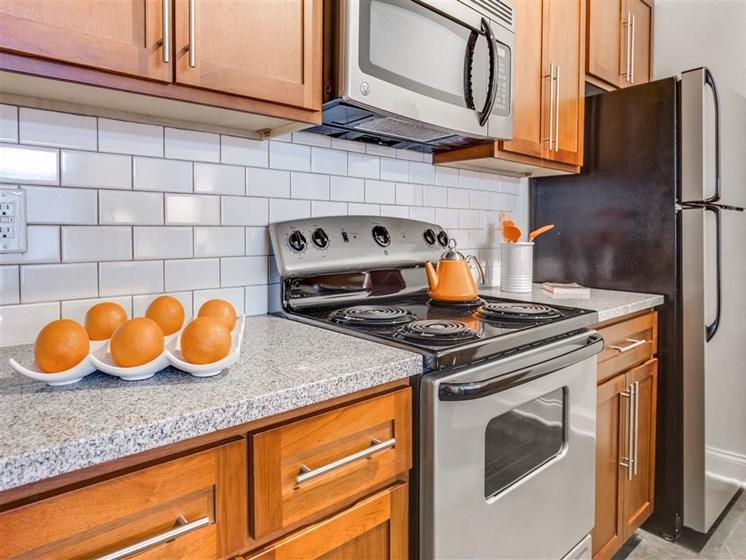 Electric Range In Kitchen at Greenway at Stadium Park, North Carolina, 27401