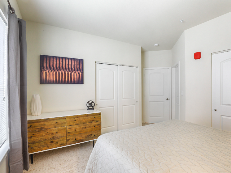 Bedroom with Attached Closet at Aventura at Maryland Oaks, Missouri