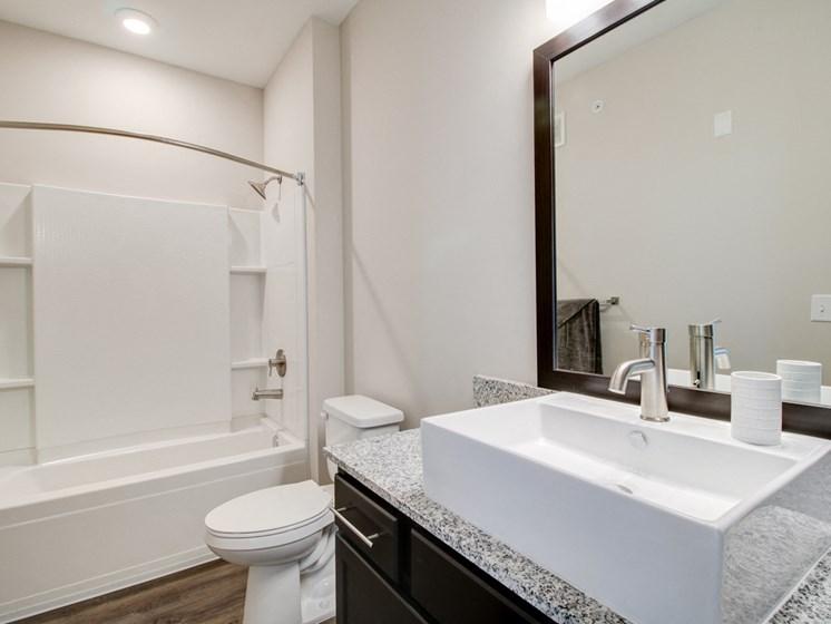 Bathroom with Vanity Mirrors at The Edison at Peytona, Gallatin, TN,37066