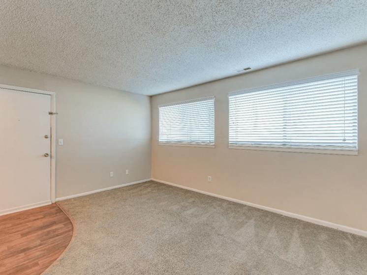 bedroom with windows at The Club at Cherry Hills Apartments