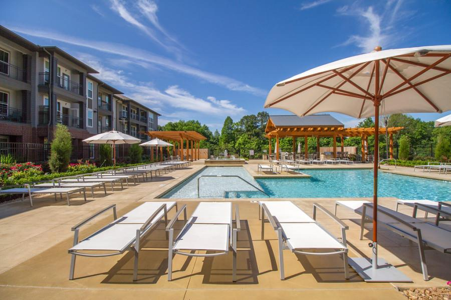 Swimming Pool with Lounge Chairs at The District, Baton Rouge,Louisiana