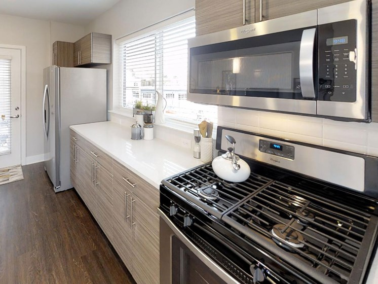 stainless appliances and optional gas range in model