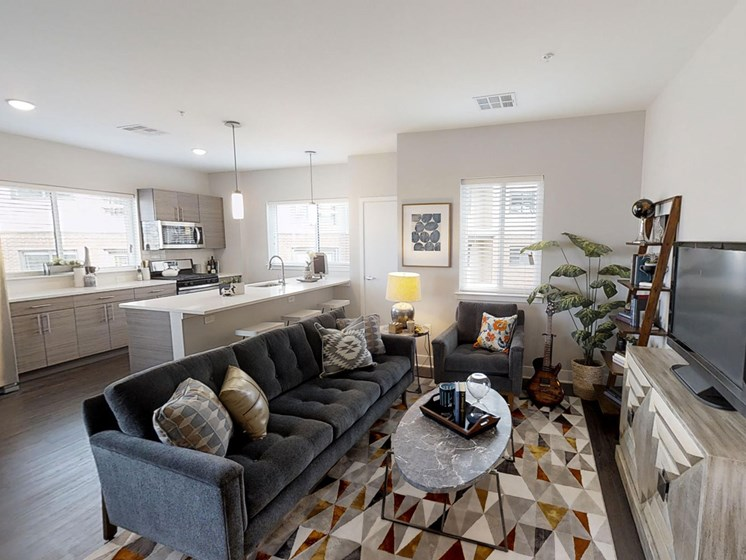 living room with kitchen in background in the ridge floor plan