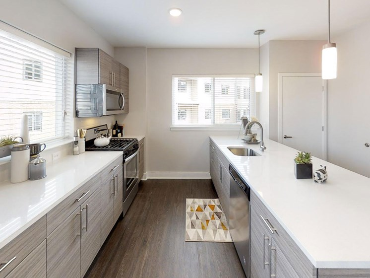 kitchen with quartz countertops and contemporary cabinetry