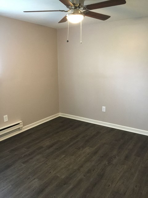 rehabbed apartment bedroom vinyl flooring