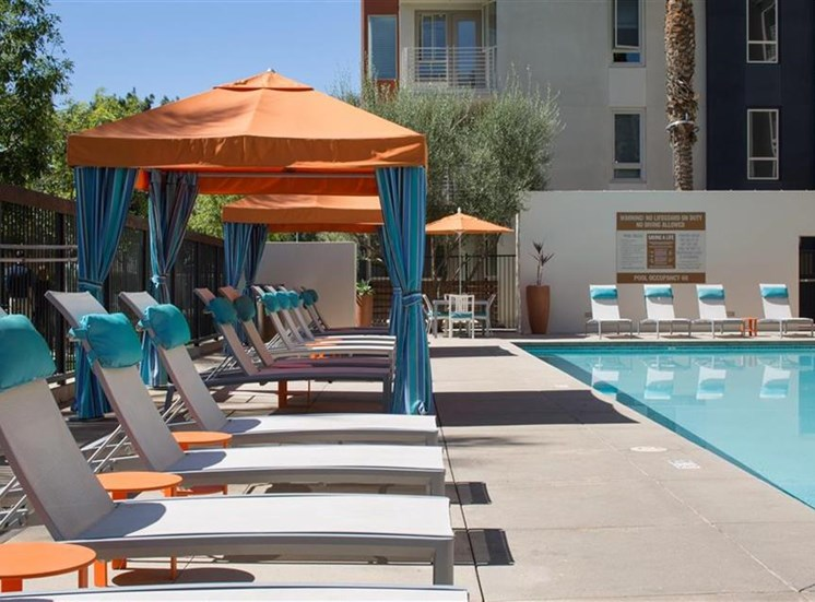 Lounge chairs at Carabella at Warner Center Apartments in Woodland Hills CA