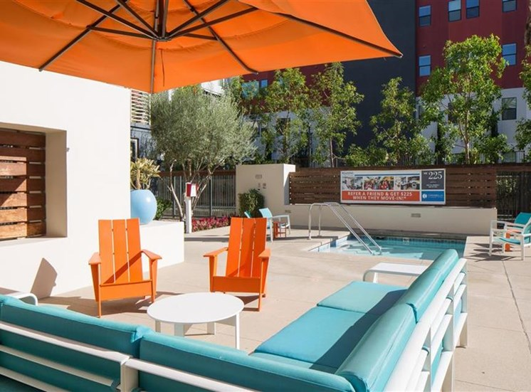Pool seating area at Carabella at Warner Center Apartments in Woodland Hills CA