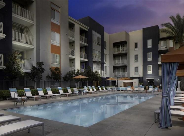 Pool at twilight at Carabella at Warner Center Apartments in Woodland Hills CA