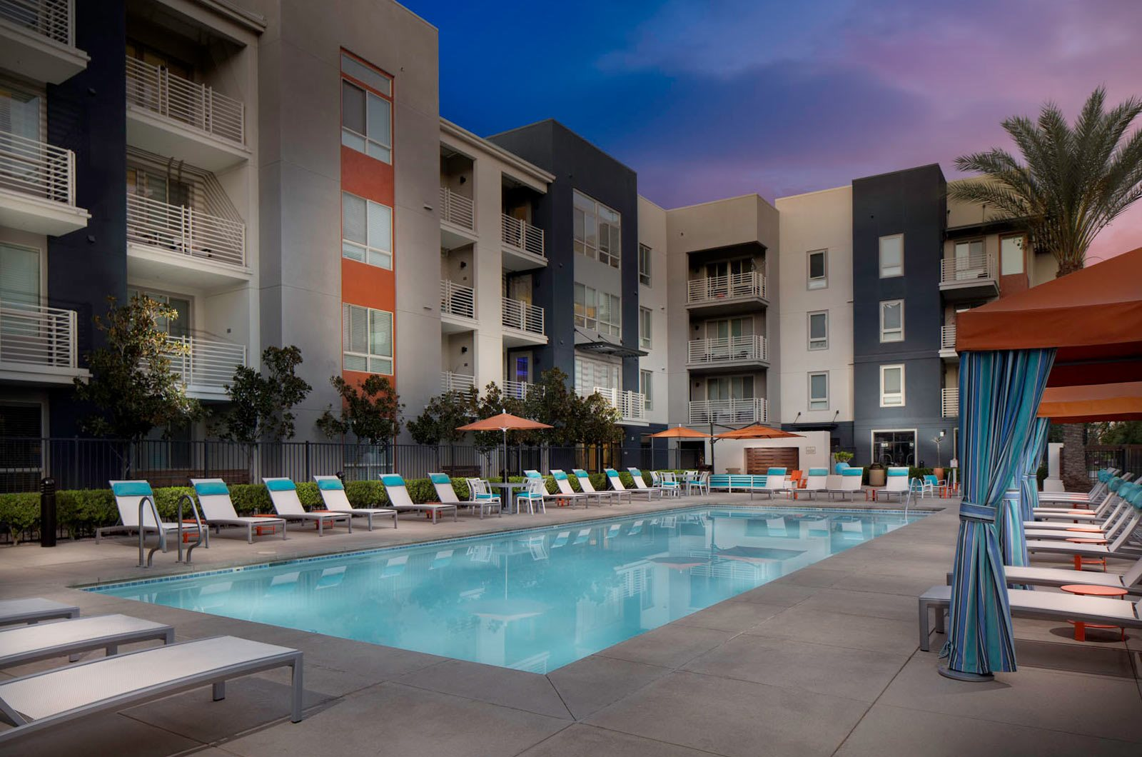 Pool at twilight at Carabella at Warner Center Apartments in Woodland Hills CA
