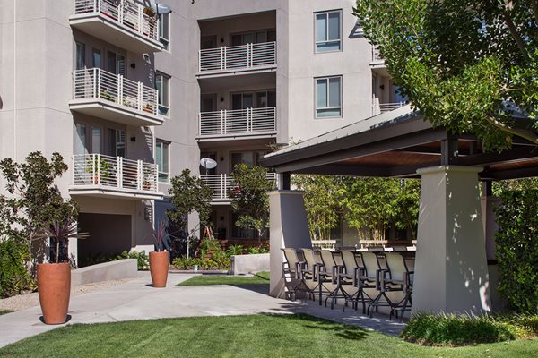 Exterior Courtyard Grilling Cabana Seating at Carabella at Warner Center Apartments in Woodland Hills CA