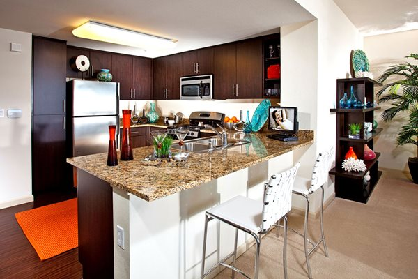 Model Kitchen Breakfast Bar at Carabella at Warner Center Apartments in Woodland Hills CA
