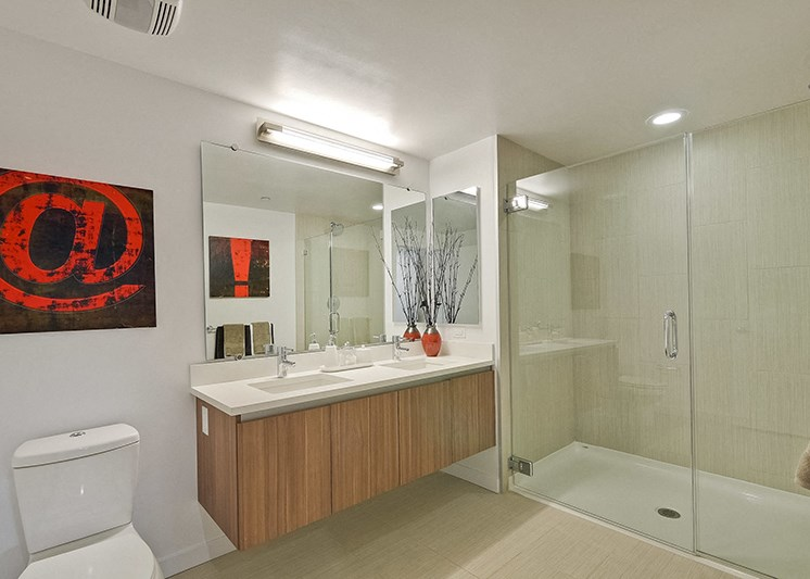 Apartments in Campbell-Revere Campbell Bathroom with Double Sink and Large Glass Shower