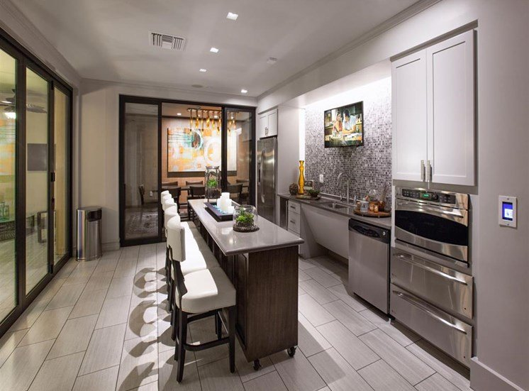 Lounge kitchen area at Terrena Apartment Homes in Northridge, CA