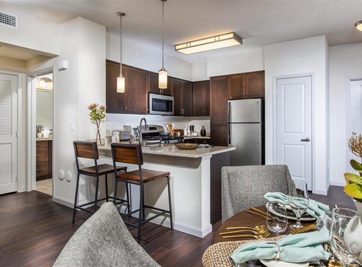 Kitchen with espresso cabinets at Capriana at Chino Hills Apartments in Chino Hills CA
