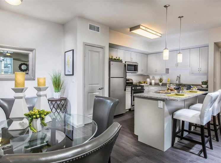 Kitchen with amazing gray cabinets at Capriana at Chino Hills Apartments in Chino Hills CA
