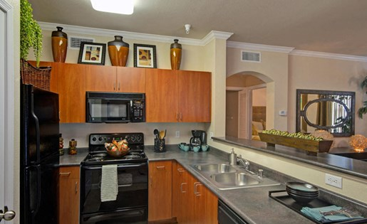 Rich cherry cabinets at Ridgestone Apartments in Lake Elsinore CA