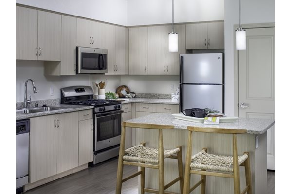 Kitchen at Pulse Millenia Apartments in Chula Vista, CA