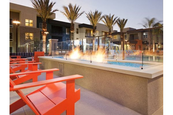 Fireplace lounge at Pulse Millenia Apartments in Chula Vista, CA