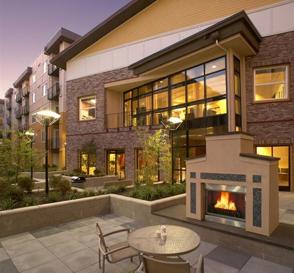 Social spaces including a fireside lounge at Sanctuary Apartments in Renton, WA