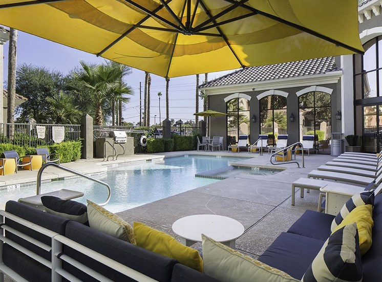 Pool seating area at Cambria Apartments in Gilbert AZ