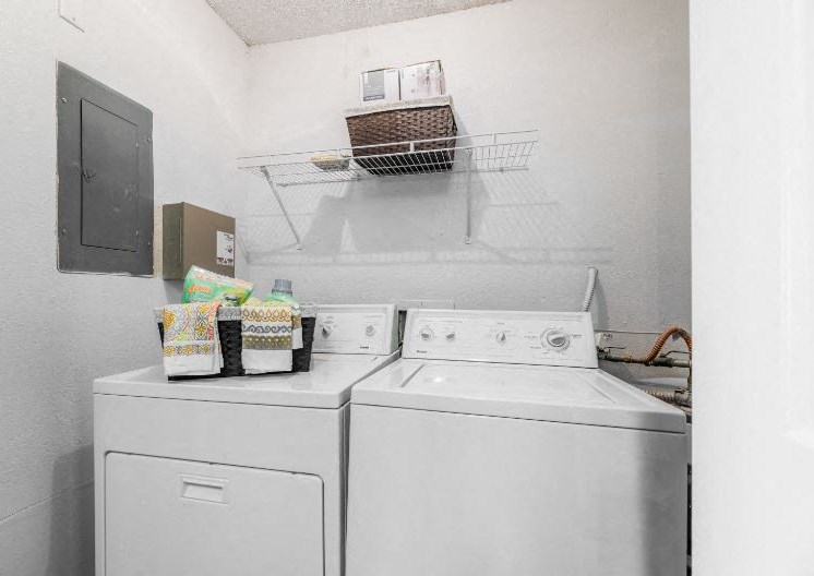 Laundry Room with Full Size Washer/ Dryer Connections