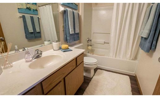Wood-style flooring in kitchens and bathrooms at Perimeter Lakes in Dublin Ohio